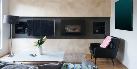 Living room with wall mounted tv and gas fireplace in warm inviting home